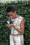 Kimberly Chandler, the wife of Knicks center Tyson Chandler, poses for a portrait with the photographer's camera at the Hyatt Union Square.<br /> <br /> <br /> Danny Ghitis for The New York Times