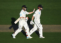 Tom Latham and Kane Williamson go to the tea break.<br /> New Zealand Blackcaps v England. 1st day/night test match. Eden Park, Auckland, New Zealand. Day 1, Thursday 22 March 2018. &copy; Copyright Photo: Andrew Cornaga / www.Photosport.nz
