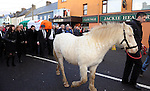 08-12-2014: The funeral of  former Kerry South TD Jackie Healy-Rae  is led by Jackie's pony 'Peig'  past his pub in Kilgarvan village following his funeral at Patrick's Church, Kilgarvan, Co. Kerry on Monday.  Picture: Eamonn Keogh ( MacMonagle, Killarney)