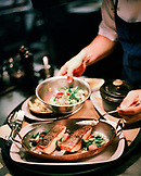USA, California, Los Angeles, sous chef preparing food in kitchen at Craft Restaurant.