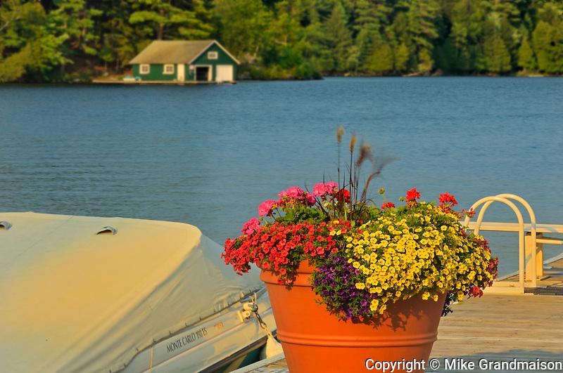 Flowerpot and boathouse, Minett, Ontario, Canada