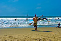 Paddleboard Surfer, walking to Ocean, Santa Monica, CA, Waters Edge, Sailboat, Surf, ocean, sand, California, USA,