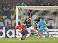 Chile defender Gonzalo Jara arrives at the last instant preventing Spain's Fernando Torres from getting off an effective shot on goal. Spain won Group H following a 2-1 defeat of Chile in Pretoria's Loftus Versfeld Stadium, Friday, June 25th, at the 2010 FIFA World Cup in South Africa..