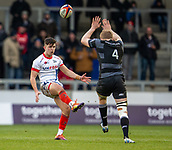 3rd February 2019, AJ Bell Stadium, Salford, England; Premiership Rugby Cup, Sale Sharks versus Newcastle Falcons; Andrew Davidson of Newcastle Falcons attempts to block a kick by Kieran Wilkinson of Sale Sharks
