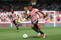Ollie Watkins of Brentford takes on the Rotherham defence during Brentford vs Rotherham United, Sky Bet EFL Championship Football at Griffin Park on 4th August 2018
