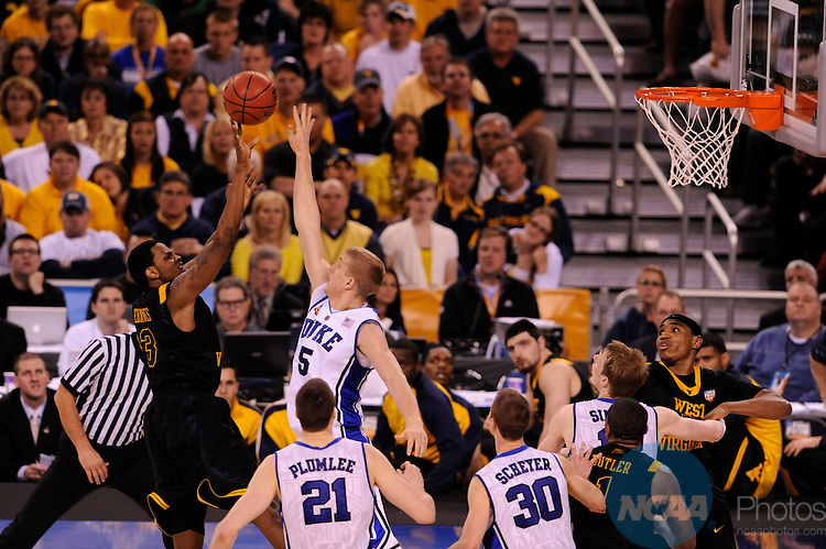 3 APR 2010: Devin Ebanks (3) of West Virginia University shoots over Mason Plumlee (5) of Duke University during the NCAA Division I Men's Basketball Semifinal game held at the Lucas Oil Stadium in Indianapolis, IN. Duke defeated West Virginia 78-57 to advance to the national championship. Brett Wilhelm/NCAA Photos