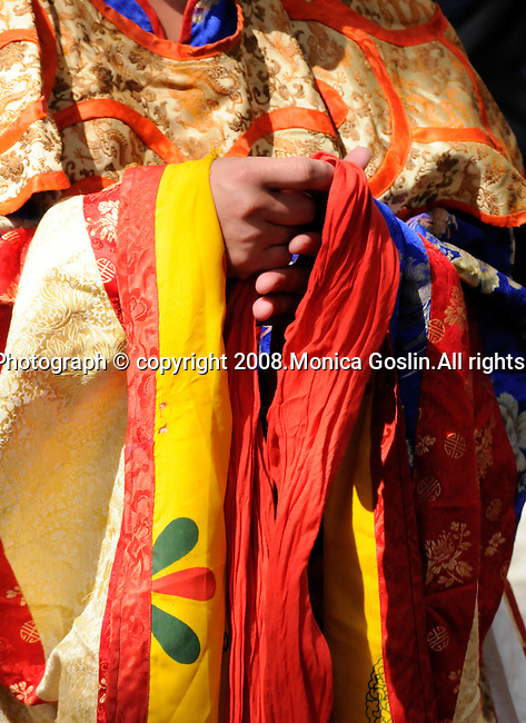 Detail of hands of a Bhutan Monk preparing to perform a dance in New York City.