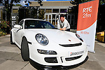Eoghan McDermott takes over the coveted drivetime slot which is sponsored by Bridgestone, Pictured outside radio centre in RTE Montrose, Eoghan McDermott and the flashy Bridgestone Porsche GT3.<br /> <br /> Picture Fran Caffrey /Newsfile