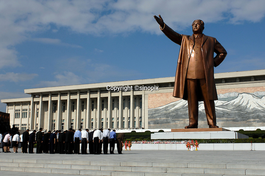 "North Koreans pay homage and bow at the statue of Kim Il-Sung, Pyongyang, North Korea. North Korea is one of the last great dictatorships where, ""Dear Leader"" Kim-Jong-il and his father Kim Il-sung ""Great Leader"" are worshipped and there is complete control of a people who are constantly reminded of the evil deeds of the west and USA."