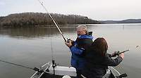NWA Democrat-Gazette/FLIP PUTTHOFF <br /> Kevin gets lines out of the water Jan. 16, 2016 while Denise fights a striped bass.