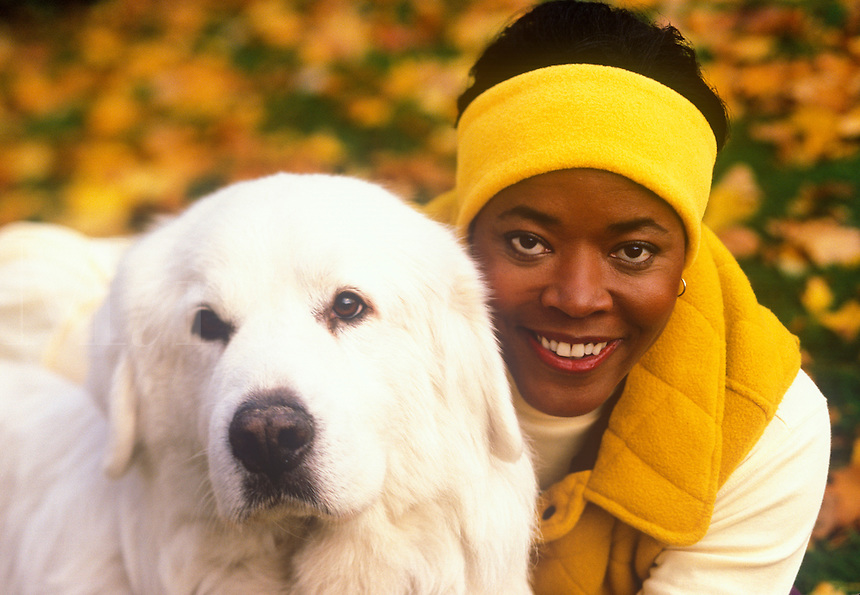 Smiling African American woman with her pet dog.