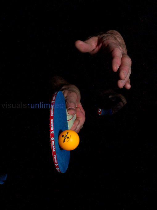 A ping pong ball as it collides with a paddle