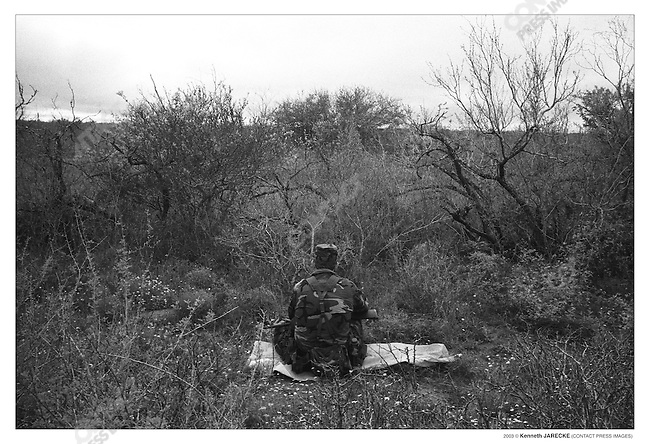 Civilian patrol group Ranch Rescue waits for illegal aliens on a private ranch. Jim Hogg County, Texas, March 2003.