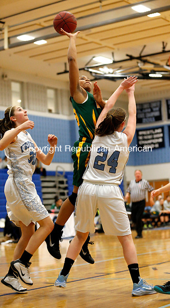Oxford, CT- 21 January 2016-012116CM11- Holy Cross' Century McCartney, goes for two against Oxford's Emily Smith (24) and Laura Trombetta during their NVL matchup in Oxford on Thursday.    Christopher Massa Republican-American