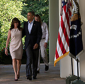 United States President Barack Obama (center) walks with the parents of U.S. Army Sergeant Bowe Bergdahl, Jani Bergdahl (left) and Bob Bergdahl (right) from the Oval Office to make a statement regarding the release of Sgt. Bowe Bergdahl by the Taliban, Saturday May 31, 2014, in the Rose Garden at the White House in Washington, D.C.<br /> Credit: John Harrington / Pool via CNP
