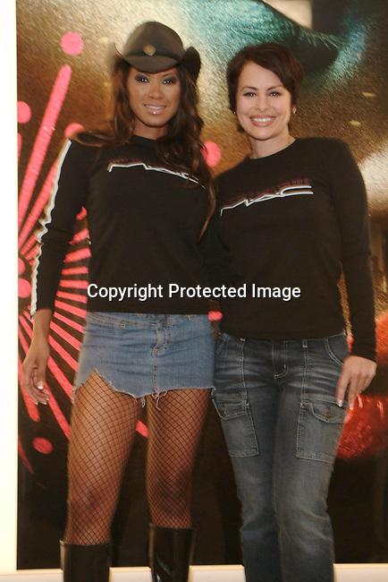 Traci Bingham &amp; Natalie Raitano<br />MAC AIDS Fund and Viva Glam on World Aids Day<br />MAC Store<br />Hollywood, CA, USA<br />December 1, 2003 <br />Photo By Celebrityvibe.com /Photovibe.com