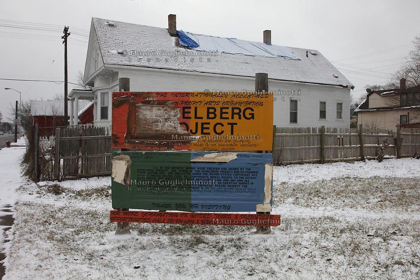 Cartello del progetto Heidelberg, all'entrata del quartiere, semidistrutto
