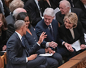 From left to right: former United States President Barack Obama, former first lady Michelle Obama, former US President Bill Clinton, and former US Secretary of State Hillary Rodham Clinton converse prior to the start of the National funeral service in honor of the late former US President George H.W. Bush at the Washington National Cathedral in Washington, DC on Wednesday, December 5, 2018.<br /> Credit: Ron Sachs / CNP<br /> (RESTRICTION: NO New York or New Jersey Newspapers or newspapers within a 75 mile radius of New York City)