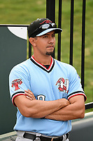 Pitching coach Jose Jaimes (20) of the Hickory Crawdads before a game against the Greenville Drive on Monday, July 23, 2018, at Fluor Field at the West End in Greenville, South Carolina. Hickory won, 6-1. (Tom Priddy/Four Seam Images)