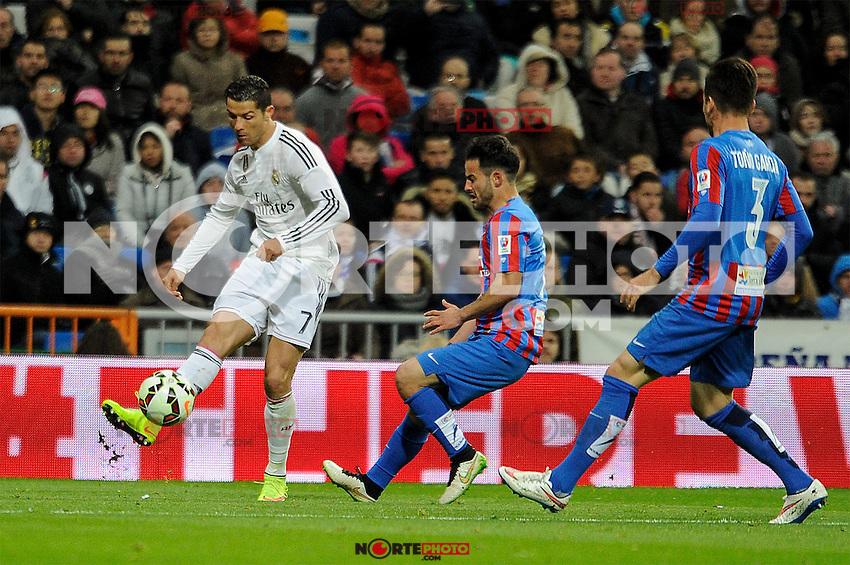 Real Madrid´s Cristiano Ronaldo and Levante UD´s Antonio Garcia Aranda during 2014-15 La Liga match between Real Madrid and Levante UD at Santiago Bernabeu stadium in Madrid, Spain. March 15, 2015. (ALTERPHOTOS/Luis Fernandez) /NORTEphoto.com