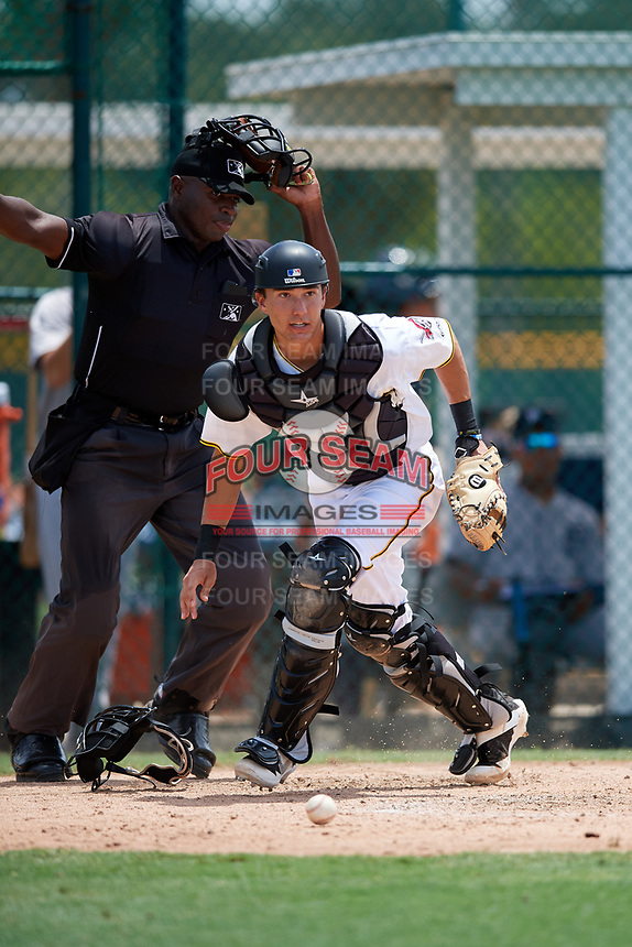 GCL Pirates catcher Ryan Haug (43) pursues a loose ball in front of home plate umpire Tre Jester during a game against the GCL Tigers West on August 13, 2018 at Pirate City Complex in Bradenton, Florida.  GCL Tigers West defeated GCL Pirates 5-1.  (Mike Janes/Four Seam Images)