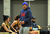 Capital coach George Le'afa during the 2015 Women's Basketball Championship plate match between the Capital Flyers (black and yellow) and Tauranga City Coasters at Te Rauparaha Arena, Porirua, Wellington, New Zealand on Thursday, 4 June 2015. Photo: Dave Lintott / lintottphoto.co.nz