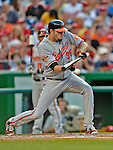 19 May 2012: Baltimore Orioles pitcher Jason Hammel lays down a sacrifice bunt against the Washington Nationals at Nationals Park in Washington, DC. The Orioles defeated the Nationals 6-5 in the second game of their 3-game series. Mandatory Credit: Ed Wolfstein Photo