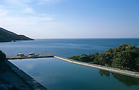 A view across the tranquil swimming pool to the Aegean sea beyond