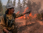 September 3, 1987 Pine Mountain Lake, California -- Stanislaus Complex Fire -- Stanislaus National Forest  foreman John Buckley gives orders to crew to keep eyes on the fire and stay safe. The Stanislaus Complex Fire consumed 28 structures and 145,980 acres.  One US Forest Service firefighter, David Ross Erickson, died from a tree-felling accident.