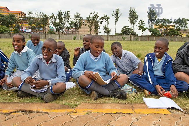 June 22, 2016; St. James Primary School students sing during class outdoors in Dandora, Kenya.  (Photo by Barbara Johnston/University of Notre Dame)