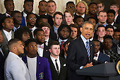Members of the 2015- 2016 College Football Playoff National Champion Alabama Crimson Tide watch while United States President Barack Obama offers remarks as he honors their championship in the East Room at The White House in Washington, D.C., Wednesday, March 2, 2016.<br /> Credit: Rod Lamkey Jr. / Pool via CNP