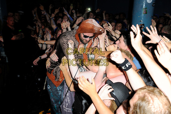 Bam Margera (Brandon Cole 'Bam' Margera)<br /> Fuckface Unstoppable performing in concert, Camden Underworld, London, England. <br /> 23rd July 2013<br /> *special rates apply*<br /> on stage in concert live gig performance performing music half length orange hooded hoody hoodie top sunglasses shades fans crowd audience necklaces brown velvet jacket beard facial hair <br /> CAP/MAR<br /> &copy; Martin Harris/Capital Pictures