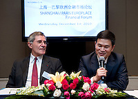 GDF Suez CEO and Paris Europlace Chairman Gerard Mestrallet (left) and Shanghai Office of Financial Services Director-General Fang Xinghai (right), answer questions after the signature of a Memorandum of Understanding between Paris Europlace and Shanghai Financial Services, at Shanghai / Paris Europlace Financial Forum, in Shanghai, China, on December 1, 2010. Photo by Lucas Schifres/Pictobank