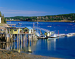 Swans Island, ME<br /> View of yellow wharf and lobster boats at Burncoat Harbor