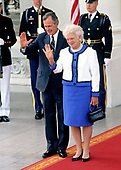 United States President George H.W. Bush, left, and first lady Barbara Bush, right, wave farewell to President Mikhail Gorbachev of the Union of Soviet Socialist Republics and his wife, Raisa, on the North Portico of the White House in Washington, DC on Sunday, June 3, 1990.  The Gorbachevs were in Washington for a three day summit that included visits to Wellesley, Massachusetts and Camp David, the presidential retreat near Thurmont, Maryland.<br /> Credit: Howard L. Sachs / CNP