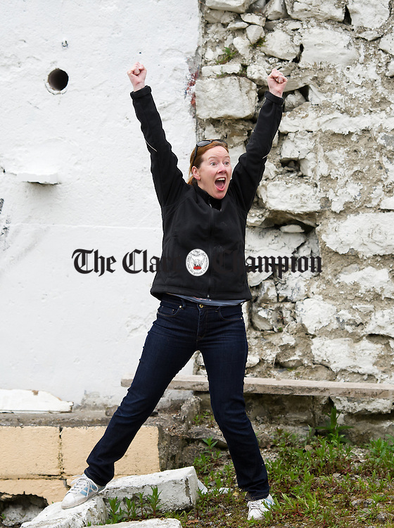 Ennis woman Christina O Reilly celebrates an early hit during the World Stone Throwing Championships as party of the Festival of Finn at Corofin. Photograph by John Kelly.