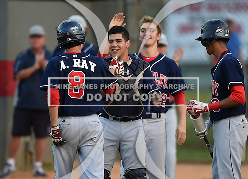 Lake Brantley Patriots catcher Luis Olivier (24) congratulates Alex Ray (8) after scoring a run with Paxton Rigby (22) during a game against the Lake Mary Rams on April 2, 2015 at Allen Tuttle Field in Lake Mary, Florida.  Lake Brantley defeated Lake Mary 10-5.  (Mike Janes Photography)