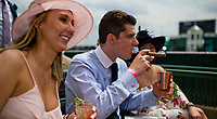 LOUISVILLE, KY - MAY 04: A man smokes a cigar and drinks a Woodford Reserve Spire on Kentucky Oaks Day at Churchill Downs on May 4, 2018 in Louisville, Kentucky. (Photo by Scott Serio/Eclipse Sportswire/Getty Images)