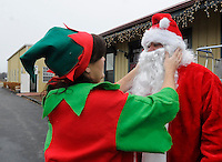 Note: Both names correct<br /> STAFF PHOTO FLIP PUTTHOFF <br /> SANTA ON THE TRAIN <br /> Wings Briggs the elf makes sure that Santa Claus, alias Dago Boscia, looks just right before Santa boards the Arkansas &amp; Missouri Railroad passenger train during a Christmas event Saturday Dec. 6 2014 at the A&amp;M depot in Springdale. The railroad offered train rides with Santa and a Santa Village was set up outside the depot with model train layouts, refreshments and holiday music.