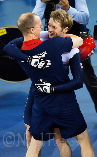 06 AUG 2012 - LONDON, GBR - Jason Kenny (GBR) of Great Britain celebrates winning the Individual Sprint Final at the London 2012 Olympic Games track cycling at the Olympic Park Velodrome in Stratford, London, Great Britain with coach Iain Dyer .(PHOTO (C) 2012 NIGEL FARROW)