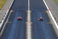 Jun 17, 2016; Bristol, TN, USA; NHRA pro stock driver Dave River (left) races alongside John Gaydosh during qualifying for the Thunder Valley Nationals at Bristol Dragway. Mandatory Credit: Mark J. Rebilas-USA TODAY Sports