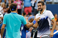 Marin Cilic of Croatia shakes hands with Roger Federer of Switzerland after winning men semifinal match at the US Open 2014 tennis tournament in the USTA Billie Jean King National Center, New York.  09.05.2014. VIEWpress