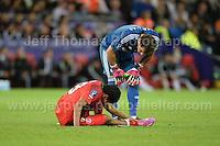 Cardiff City Stadium, Cardiff, South Wales - Tuesday 12th Aug 2014 - UEFA Super Cup Final - Real Madrid v Sevilla - <br /> <br /> Sevilla&rsquo;s Carlos Bacca suffers cramp during the match. <br /> <br /> <br /> <br /> <br /> Photo by Jeff Thomas/Jeff Thomas Photography
