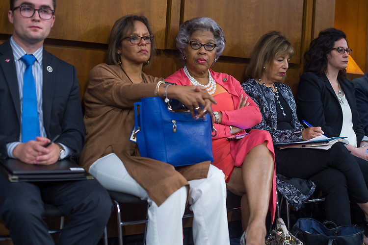 UNITED STATES - JUNE 8: Reps. Robin Kelly, D-Ill., second from left, Joyce Beatty, D-Ohio, center, and Jackie Speier, D-Calif., second from right, attend a Senate Select Intelligence Committee hearing about Russian interference in the 2016 election featuring testimony by former FBI Director James Comey on June 8, 2017. (Photo By Tom Williams/CQ Roll Call)
