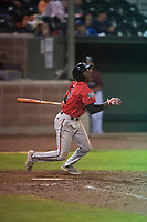 Billings Mustangs left fielder Zeek White (6) follows through on his swing during a Pioneer League game against the Idaho Falls Chukars at Melaleuca Field on August 22, 2018 in Idaho Falls, Idaho. The Idaho Falls Chukars defeated the Billings Mustangs by a score of 5-3. (Zachary Lucy/Four Seam Images)