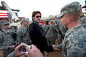 Al-Asad, Iraq - December 19, 2009 -- Musician Billy Ray Cyrus greets troops in Al-Asad, Iraq on Saturday, December 19, 2009. United States Navy Admiral Mike Mullen, chairman of the Joint Chiefs of Staff  and his wife Deborah are hosting the USO Holiday Troop Visit with tennis star Anna Kournikova, comedian Dave Attell, tennis coach Nicholas Bollettiere visiting troops in Afghanistan, Iraq and Germany. .Mandatory Credit: Chad J. McNeeley - DoD via CNP