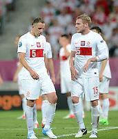 FUSSBALL  EUROPAMEISTERSCHAFT 2012   VORRUNDE Tschechien - Polen               16.06.2012 Darius Dudka (li) und Damien Perquis (re, beide Polen) sind enttaeuscht
