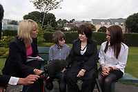 Pictured: Sonia Oatley (3rd L) mother of tragic teen Rebecca Aylward with her young son Jack (2nd L) and daughter Jessica (R) interviewed outside Swansea Crown Court. Friday 02 September 2011<br /> Re: A 16-year-old boy who battered his former girlfriend to death has been sentenced to a minimum of fourteen years in prison by a judge at Swansea Crown court today (Fri 02 September 2011) for her murder.<br /> Rebecca Aylward, 15, from Maesteg, was lured into a wood in Aberkenfig, near Bridgend, in October 2010. <br /> Joshua Davies denied murder, blaming his friend, but was convicted by a 10-2 majority verdict in July.