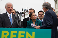 """Senator Ed Markey, Democrat of Massachusetts, greets  Representative Alexandria Ocasio-Cortez, Democrat of New York,  prior to speaking during a press conference to announce the """"Green New Deal"""" held at the United States Capitol in Washington, DC on February 7, 2019. Credit: Alex Edelman / CNP/AdMedia"""