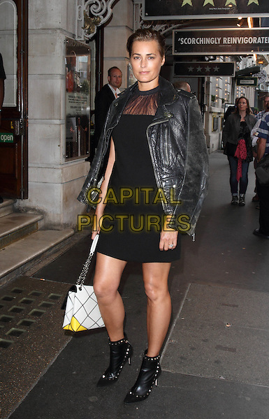Yasmin Le Bon.Press Night for the RSC's 'Julius Caesar' at the Noel Coward Theatre, St Martins Lane, London, England..August 15th 2012.full length black dress leather jacket ankle boots over shoulder white bag purse .CAP/ROS.©Steve Ross/Capital Pictures.